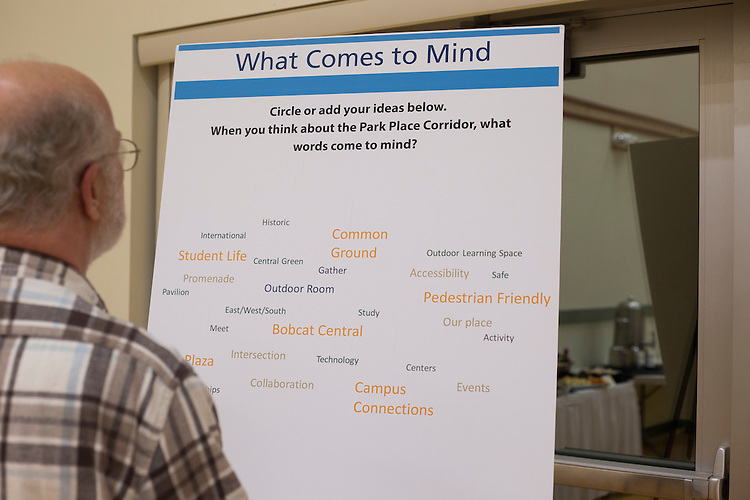 Tim Traxler, a long-time Athens resident, reads one of the boards during the Park Place public planning workshop at the Athens Community Center on Feb. 22, 2017.