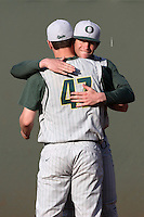 Jake Reed #5 of the Oregon Ducks hugs teammate Alex Keudell #47 before pitching against the UCLA Bruins at Jackie Robinson Stadium on April 6, 2012 in Los Angeles,California. Oregon defeated UCLA 8-3.(Larry Goren/Four Seam Images)