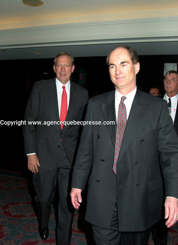 Montreal, April 18, 2001<br /> New York State Governor ; George E Pataki,(left) walk with ``Conference of Montreal ``founder and President ;  Gil R&Egrave;millard before his speech at the `` Conference of Montreal `` on economy globalization, April 18, 2001 in Montreal, CANADA