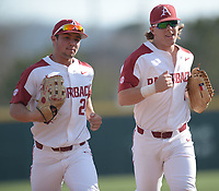 NWA Democrat-Gazette/ANDY SHUPE<br />Arkansas center fielder Dominic Fletcher (left) and right fielder Eric Cole head to the dugout against Kent State Friday, March 9, 2018, in the middle of the third inning at Baum Stadium in Fayetteville. Visit nwadg.com/photos to see more photographs from the game.