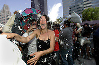 LOS ANGELES,CA - APRIL 4,2009: Feathers flew as several hundred heard the call to BYOP ( bring your own pillow) to Pershing Square on Saturday April 4, 2009. Safira VanderZee, center, participates in one of hundreds of World Pillow Fight Day events. LA Burners hosted the downtown Los Angeles edition of the global event. Other citys  hosting events include: Amsterdam, Ann Arbor , Atlanta, Belgrade, Boston, Boulder, CO and Budapest. www.pillowfightday.com