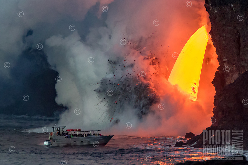 """Too Close: (Published Scholastic News, March/April 2017) A lava tour boat gets close to the largest lava fall/lava """"fire hose"""" and littoral explosions in recent history, Kamokuna, Hawai'i Volcanoes National Park, Big Island."""