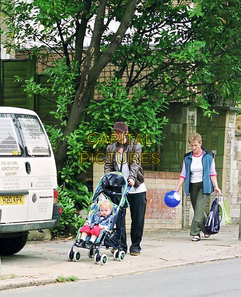03/08/2001 London  .Liam Gallagher (Oasis) & mother PEGGY GALLAGHER & Liam's son .LENNON GALLAGHER returning to Liam's home after a shopping trip..**Picture Exclusive**.*PLEASE CREDIT ALL USES*.tel +44 (0)20 7253 1122.sales@capitalpictures.com.www.capitalpictures.com.© Capital Pictures.buggy, celeb parent