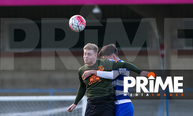 Rowan Liburd of Reading beats Shane Griffin of Reading to the ball during the Barclays U21 Premier League match between Reading and Everton at Adams Park, High Wycombe, England on 9 December 2015. Photo by Andy Rowland.