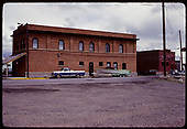 View of 2 brick buildings behind Montrose station - warehouses?<br /> D&amp;RGW  Montrose, CO