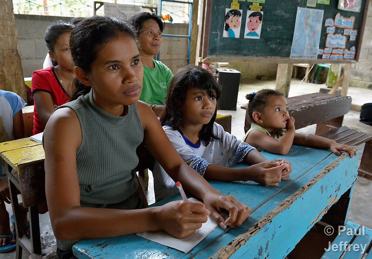 Girls and women in a literacy class in the village of Inopawan, in New Bataan in the Compostela Valley on Mindanao Island in the southern Philippines.