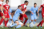 27 November 2011: Indiana's Kerel Bradford (in red) and North Carolina's Billy Schuler (in blue). The University of North Carolina Tar Heels defeated the Indiana University Hoosiers 1-0 in overtime at Fetzer Field in Chapel Hill, North Carolina in an NCAA Men's Soccer Tournament third round game.