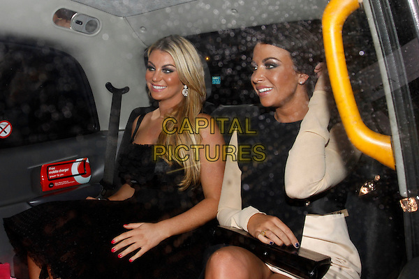 Billi Mucklow and Cara Kilbey.Hybrid and OK! Magazine London Fashion Week Party, Jewel Bar, London, England..22nd February 2012.half length black beige dress sitting car cab taxi .CAP/AH.©Adam Houghton/Capital Pictures.