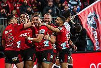 Seta Tamanivalu of the Crusaders celebrates with team mates after scoring a try during the 2018 Super Rugby final between the Crusaders and Lions at AMI Stadium in Christchurch, New Zealand on Sunday, 29 July 2018. Photo: Joe Johnson / lintottphoto.co.nz