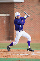 Tony Fortier-Bensen (8) of the High Point Panthers follows through on his swing against the UNCG Spartans at Willard Stadium on February 14, 2015 in High Point, North Carolina.  The Panthers defeated the Spartans 12-2.  (Brian Westerholt/Four Seam Images)