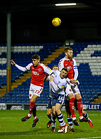 Fleetwood Town's Harrison Biggins and Cian Bolger battle in the air with Bury's Ryan Cooney<br /> <br /> Photographer Alex Dodd/CameraSport<br /> <br /> The EFL Checkatrade Trophy Group B - Bury v Fleetwood Town - Tuesday 13th November 2018 - Gigg Lane - Bury<br />  <br /> World Copyright &copy; 2018 CameraSport. All rights reserved. 43 Linden Ave. Countesthorpe. Leicester. England. LE8 5PG - Tel: +44 (0) 116 277 4147 - admin@camerasport.com - www.camerasport.com