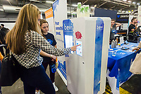Workers from Bevi demonstrate their beverage machine to attendees at the TechDay New York event on Tuesday, April 18, 2017. Thousands attended to seek jobs with the startups and to network with their peers. TechDay bills itself as the U.S.'s largest startup event with over 500 exhibitors. (© Richard B. Levine)