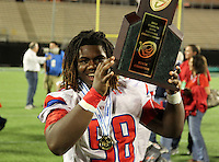 Manatee Hurricanes defensive lineman Jorelle Simmons #58 hoists the Championship trophy after the Florida High School Athletic Association 7A Championship Game at Florida's Citrus Bowl on December 16, 2011 in Orlando, Florida.  Manatee defeated First Coast 40-0.  (Mike Janes/Four Seam Images)