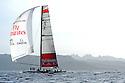Louis Vuitton Trophy La Maddalena 1 giugno 2010. Emirates Team New Zealand naviga sotto spi durante una regata con gli svedesi di Artemis. Sullo sfondo i monti che orlano il golfo di Arzachena