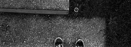 Trent feet and sprinkler head in front of Nelson home.<br />