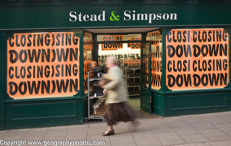 Stead and Simpson shoe shop closing down posters in window, Woodbridge, Suffolk, England