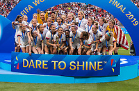 LYON,  - JULY 7: Alex Morgan #13, Carli Lloyd #10 and the USWNT celebrate with the FIFA Women's World Cup trophy during a game between Netherlands and USWNT at Stade de Lyon on July 7, 2019 in Lyon, France.