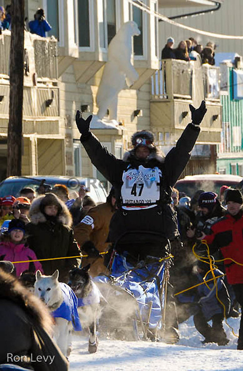 Lance Mackey arrives down Front St. amidst crowds and cheers in Nome, Alaska to win Iditarod 37, March 18, 2009, noon.