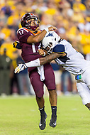 Landover, MD - SEPT 3, 2017: Virginia Tech Hokies quarterback Josh Jackson (17) takes a big hit after throwing a pass during game between West Virginia and Virginia Tech at FedEx Field in Landover, MD. (Photo by Phil Peters/Media Images International)