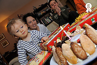 French family celebrating boy's first birthday (Licence this image exclusively with Getty: http://www.gettyimages.com/detail/85071277 )