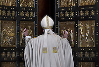 "Pope Francis opens a ""Holy Door"" at St Peter's basilica to mark the start of the Jubilee Year of Mercy, on December 8, 2015"