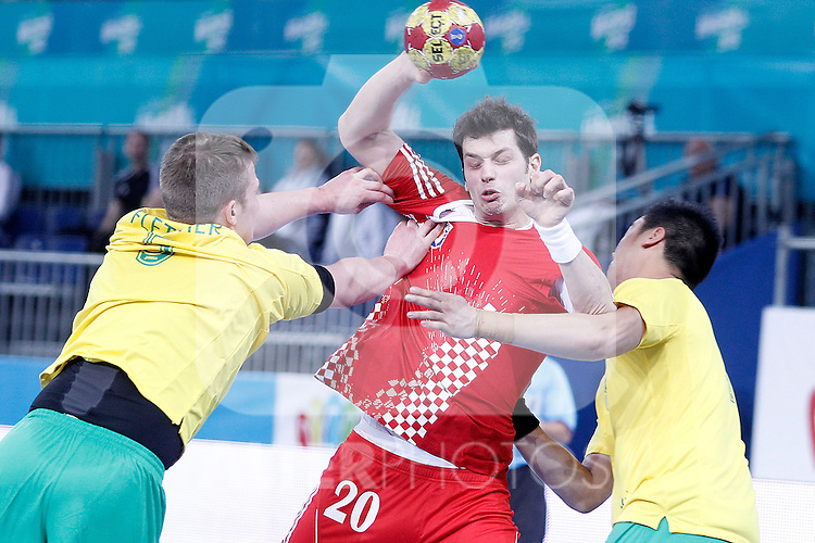 Croatia's Damir Bicanic (c) and Australia's Tommy Fletcher (l) during 23rd Men's Handball World Championship preliminary round match.January 12 ,2013. (ALTERPHOTOS/Acero)