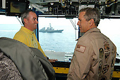 "United States President George W. Bush gets a tour of Primary Flight Control (Pri-Fly) from the ""Air Boss"" Commander Toon during a his visit aboard USS Abraham Lincoln (CVN 72) on May 1, 2003.  The President is conducting a visit aboard ship to meet with the Sailors and will address the Nation as Lincoln prepares to return from a 10-month deployment to the Arabian Gulf in support of Operation Iraqi Freedom. <br /> Credit: United States Navy via CNP"