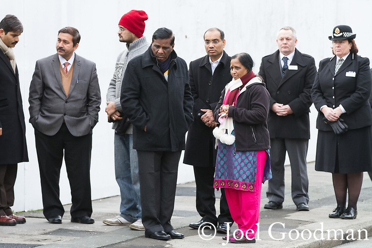 © Joel Goodman - 07973 332324 . 02/01/2012 . Salford , UK . Anuj's father and mother Subhash and Yogini . The parents of Anuj Bidve visit the scene of Anuj Bidve's murder, on Ordsall Lane , where a memorial shrine of flowers, candles and messages has been built . Bidve was shot and killed by Kiaran Stapleton on 26 December 2011 . Photo credit: Joel Goodman