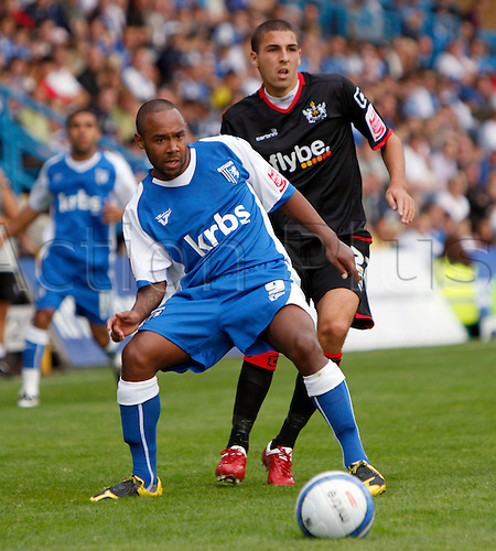 5th September 2009. Gillingham's Chris Palmer shields the ball from Liam Sercombe during the second half. Division 1 match - Gillingham v Exeter City at Priestfield Stadium, Gillingham, Kent, England.