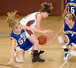 NAUGATUCK, CT- 02 JAN 06- 010207JT17- <br /> From left, Seymour's Caitlin Eastwood, Naugatuck's Julie Piroscafo, and Seymour's Heather Lee scramble for a loose ball during Tuesday's game at Naugatuck. Seymour won 41-44.<br /> Josalee Thrift Republican-American