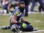 Seattle Seahawks linebacker Bruce Irvin (51) stretches out before their game against the Cleveland Browns at CenturyLink Field in Seattle, Washington on December 20, 2015. The Seahawks clinched their fourth straight playoff berth in four seasons by beating the Browns 30-13.  ©2015. Jim Bryant Photo. All Rights Reserved.