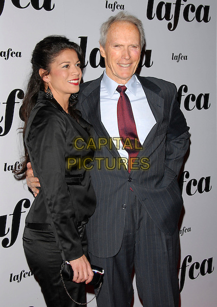 DINA EASTWOOD & CLINT EASTWOOD.attends The 32nd Annual Los Angeles Film Critics Association Awards (LAFCA) held at The InterContinental Los Angeles in Century City, California, USA, .January 14 th 2007..half length.CAP/DVS.©Debbie VanStory/Capital Pictures