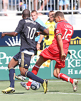 Danny Mwanga #10 of the Philadelphia Union moves in on Adrian Cann #12 of Toronto FC during an MLS match at PPL stadium in Chester, PA. on July 17 2010. Union won 2-1 with a last minute penalty kick goal.
