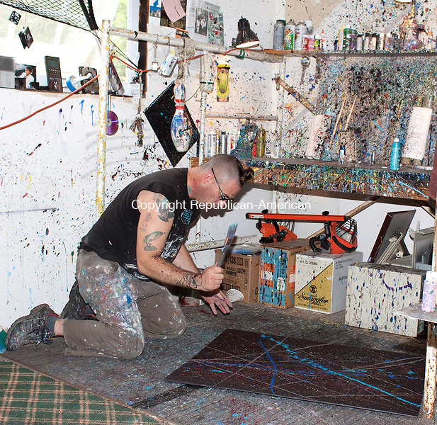 SOUTHBURY CT-28 JULY 2011-072811DA08- Dave Brooker, a Southbury artist works on a painting simular to a giant  10'x4' canvas painting he created for the first Local Musicians Collaborative Festival in Southbury, set for Aug. 13 to benefit Cystic Fibrosis Foundation. The painting will be for sale at the event in 8x10 inch pieces that the customer gets to pick out from the large 10'x4' painting by literally taking an 8x10 piece of plywood and marking off his or her chosen area.<br /> Darlene Douty Republican-American