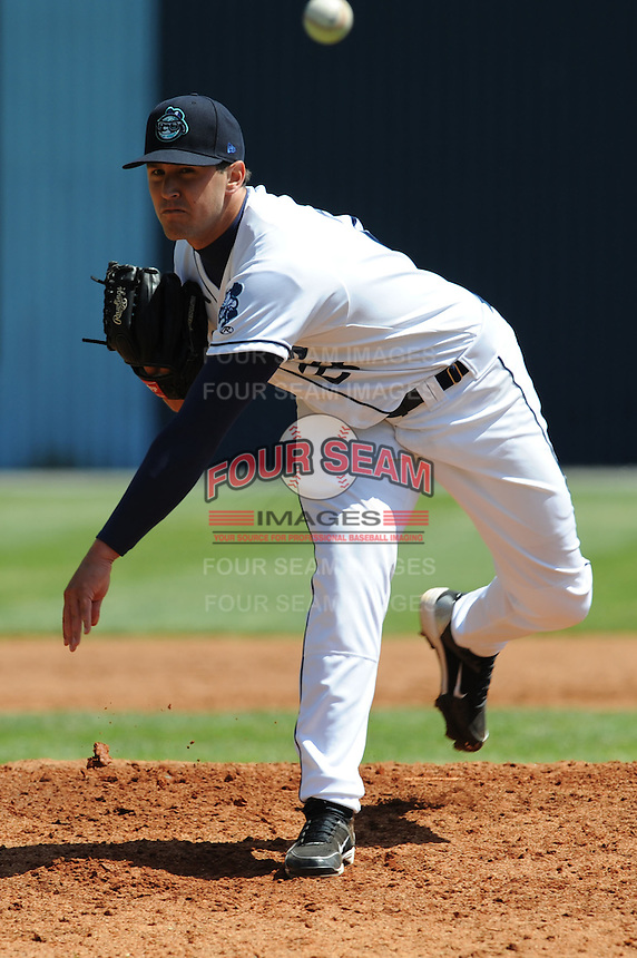 Asheville Tourists Craig Bennigson #27 delivers a pitch during a game against  the Lexington Legends at McCormick Field in Asheville,  North Carolina;  April 17, 2011. Lexington defeated Aheville 18-9.  Photo By Tony Farlow/Four Seam Images