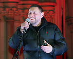 "© Joel Goodman - 07973 332324 .  03/02/2015 . Manchester , UK . Madchester star SHAUN RYDER , speaks to the crowd , at the demonstration . Demonstration organised by the Labour Party on the steps of Manchester City Council in Albert Sqaure , Manchester , under the banner ""manVcam"" ( Manchester vs Cameron ) . Organisers say Manchester - along with Liverpool and Birmingham - have suffered larger cuts than other regional authorities , whilst southern regions such as Surrey , Hampshire and West Sussex have all seen increases in government funding . Photo credit : Joel Goodman"