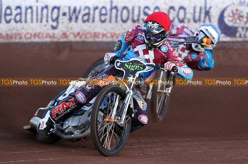 Heat 2: Richie Worrall (red) and Robert Mear (blue) - Lakeside Hammers vs Peterborough Panthers, Elite League Speedway at the Arena Essex Raceway, Pufleet - 11/05/12 - MANDATORY CREDIT: Rob Newell/TGSPHOTO - Self billing applies where appropriate - 0845 094 6026 - contact@tgsphoto.co.uk - NO UNPAID USE..