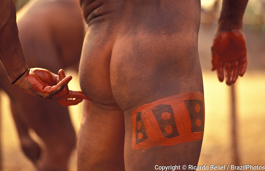 "Indigenous People from Amazon rainforest in Brazil celebrating Yamuricuma Party at Kamayura tribe, a meeting of several indigenous groups from the south part of Xingu river. Body painting with urucum, known as the source of the natural pigment annatto. It is of particular commercial value in the United States because the Food and Drug Administration considers colorants made from it to be ""exempt of certification"". It is used as a colorant and condiment for traditional dishes such as cochinita pibil, rice, chicken in achiote and caldo de olla. It is also used to add color to butter, cheese, popcorn, drinks, and breads. The festival culminates in a wrestling contest called Huka-Huka. Wrestling matches usually only last for a few seconds until one opponent is either actually thrown down or 'thrown down' by default (when the other wrestler has grabbed both of their knees in such a way that it would inevitably lead to them being knocked to the ground)."