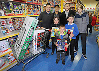 Pictured: Kyle Naughton and Gylfi Sigurdsson Wednesday 08 December 2016<br />Re: Swansea City FC players have bought Christmas gifts for 60 children at Smyths toy store in Swansea, south Wales.