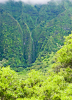 The Ko'olau mountains stream with waterfalls as seen from the windward side of Oahu after heavy rains