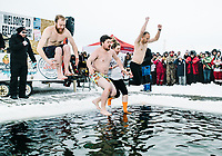 Spectators and swimmers enjoy the Polar Pout Plunge during the 39th Annual International Eelpout Festival, at Leech Lake in Walker, Minnesota, February 24, 2018. Crowds that are more than 10 times the population of tiny Walker, Minn. (pop. 1,069) gather on Minnesota&rsquo;s third largest lake (112,000-acres), Leech Lake, for a festival named for one of the ugliest bottom-dwelling fish, the eelpout.<br /> <br /> Photo by Matt Nager