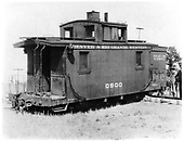 D&amp;RGW short caboose #0500 derailed during scarpping of Rio Grande and Western railroad in NM.<br /> D&amp;RGW  south of El Vado, NM  1928
