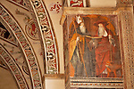 A 15th century fresco of Saints in the Santa Maria delle Grazie Church in Gravedona, a town on Lake Como Italy