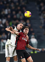 Calcio, Serie A: Juventus - Milan, Turin, Allianz Stadium, November 10, 2019.<br /> Juventus' captain Leonardo Bonucci (l) in action with Milan's Krzysztof Piatek (r) during the Italian Serie A football match between Juventus and Milan at the Allianz stadium in Turin, November 10, 2019.<br /> UPDATE IMAGES PRESS/Isabella Bonotto