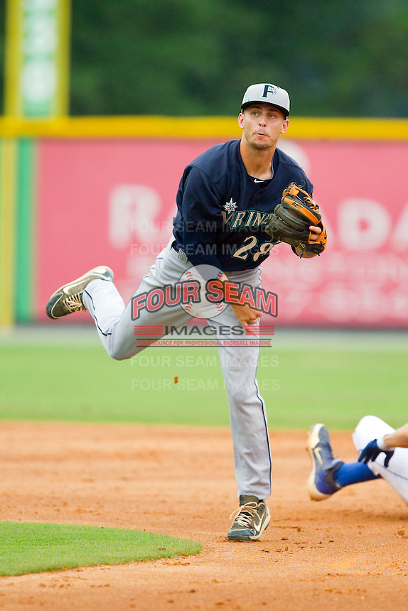 Pulaski Mariners second baseman Zach Shank (28) makes a throw to first base against the Burlington Royals at Burlington Athletic Park on July 20, 2013 in Burlington, North Carolina.  The Royals defeated the Mariners 6-5.  (Brian Westerholt/Four Seam Images)
