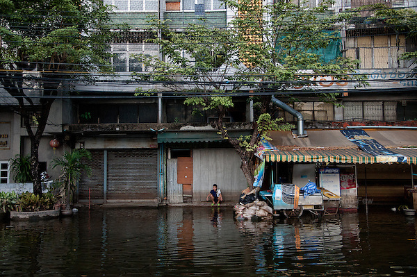 Flooding in western Bangkok.<br /> <br /> Thailand's worst floods for 50 years finally reached the suburbs of Bangkok in October 2011. While the government dithered and argued with itself, more than 200 people died.