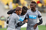 Newcastle players Mapou Yanga-Mbiwa, right and, Massadio Haïdara, centre congratulate Yoan Gouffran, left, after he scored against the Wellington Phoenix in the fourth match of the Football United Tour at Westpac Stadium, Wellington, New Zealand, Saturday, July 26, 2014. Credit: Dean Pemberton