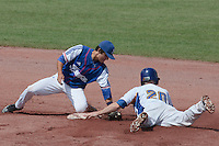 30 july 2010: Maxime Lefevre of France fails to tag out Christoffe Johansson of Sweden who dives safely into second base during Sweden 3-2 win over France, in day 6 of the 2010 European Championship Seniors, at TV Cannstatt ballpark, in Stuttgart, Germany.