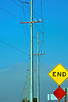 End Road Sign, Wind Turbine Farm, Power Transmission Lines, high voltage, transmission networks.