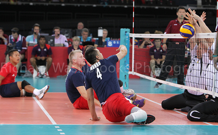 Paralympics London 2012 - ParalympicsGB - Volleyball..John Munro shot is blocked by the German team during the Men's Preliminiaries Pool A - Match 24 Great Britain vs Germany 3rd September 2012 held at the Excel Centre at the Paralympic Games in London. Photo: Richard Washbrooke/ParalympicsGB